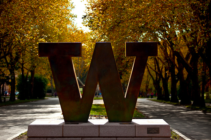 Bronze W at the entrance to campus